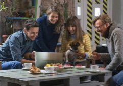 Group of friends feeling good and having breakfast together in a hipster interior